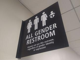 640px-All_gender_restroom_sign_San_Diego_airport.jpg
