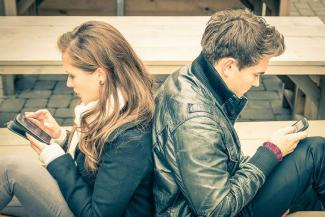 Couple_looking_at_phones_Credit_View_Apart_Shutterstock_CNA.jpg
