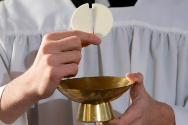 web3-priest-eucharist-host-shutterstock_241121287.jpg